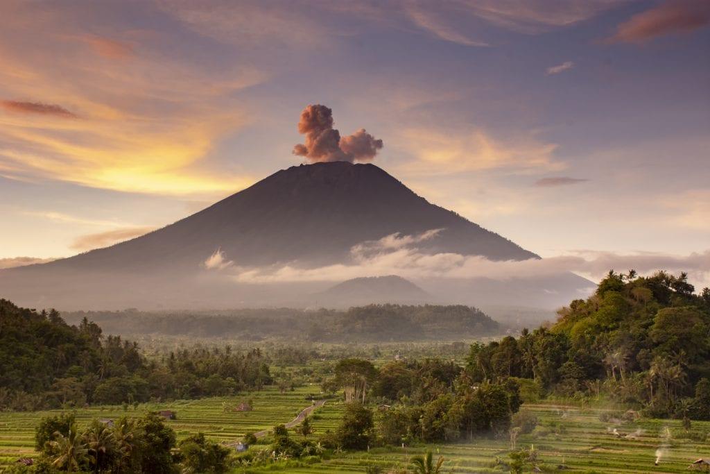 Plumes of smoke at Mount Agung during sunrise.