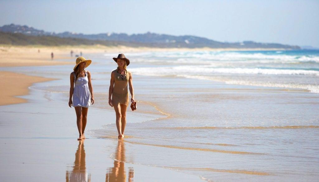 Two women walking on Marcoola Beach