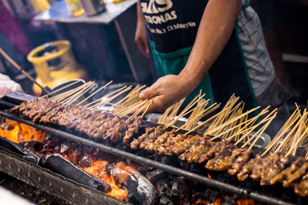 Flame-grilled satay skewers in Surabaya, Indonesia