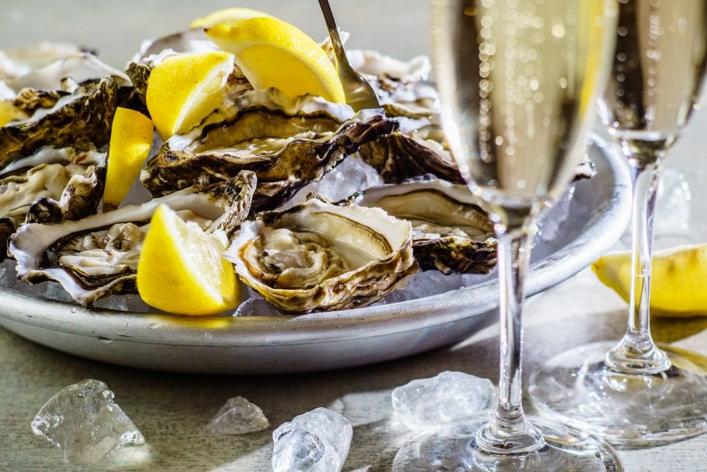 Freshly-shucked oysters and champagne
