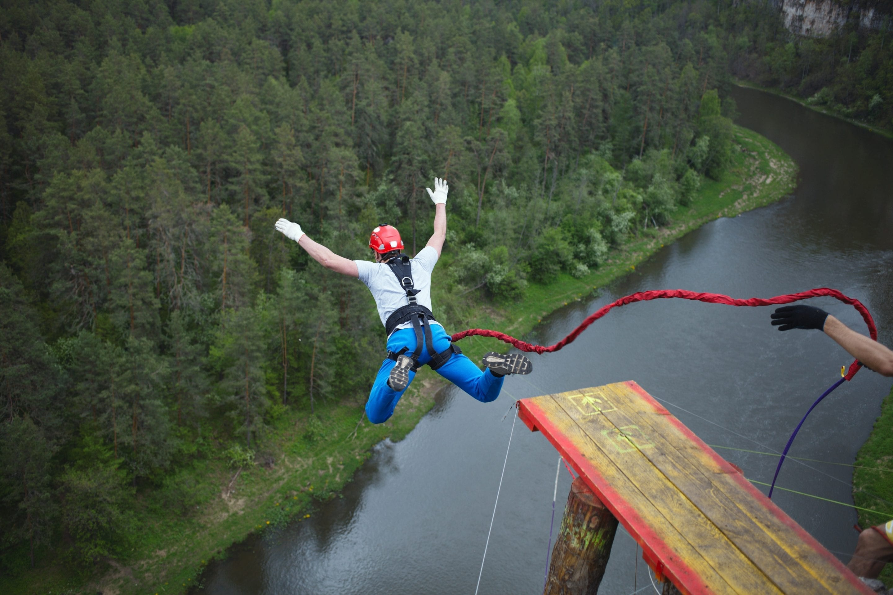 Man bungee jumping above river